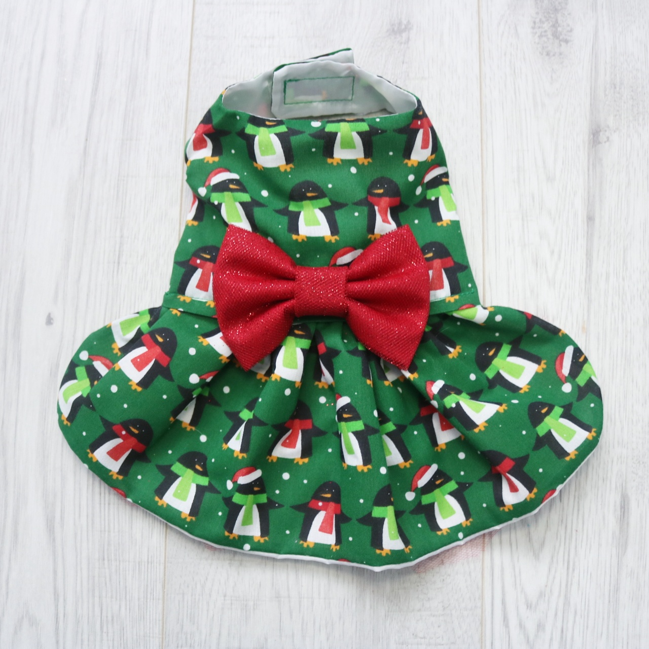 green christmas dog dress with penguin design