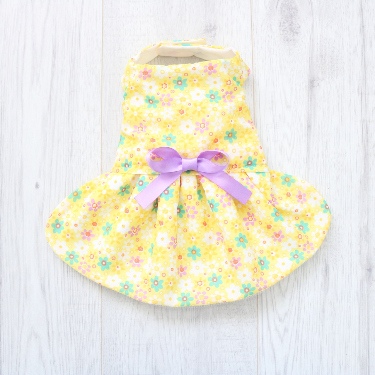 yellow floral dog dress with purple ribbons