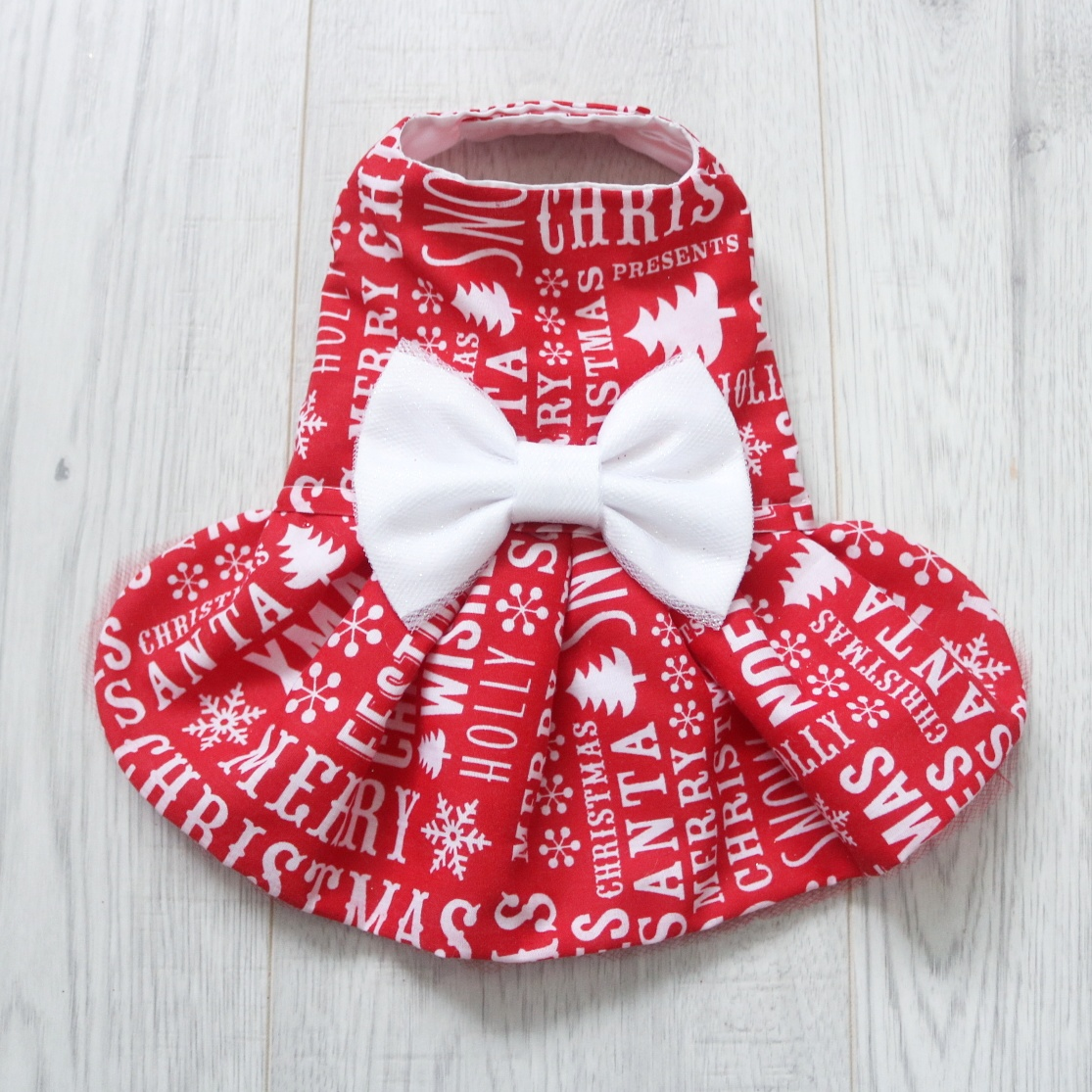 Red christmas dog dress with white writing
